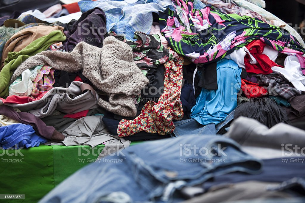 Piles of clothing at outdoor flea market street stall royalty-free stock photo