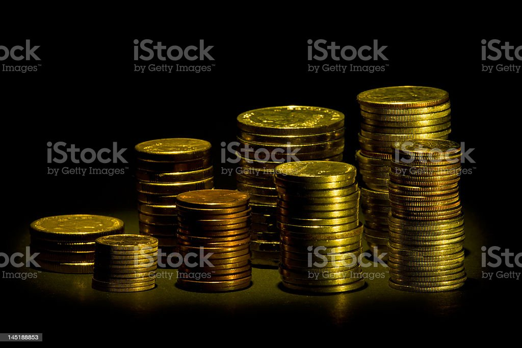 Piles of coins over black royalty-free stock photo