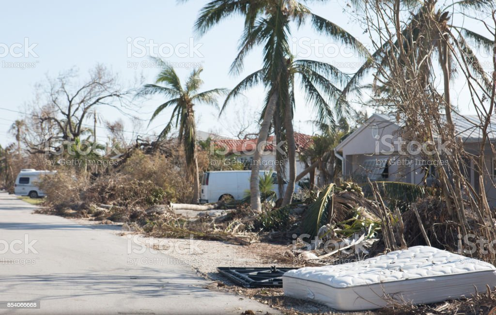 Piles of debris including bedding destroyed by flooding caused by hurricane. stock photo