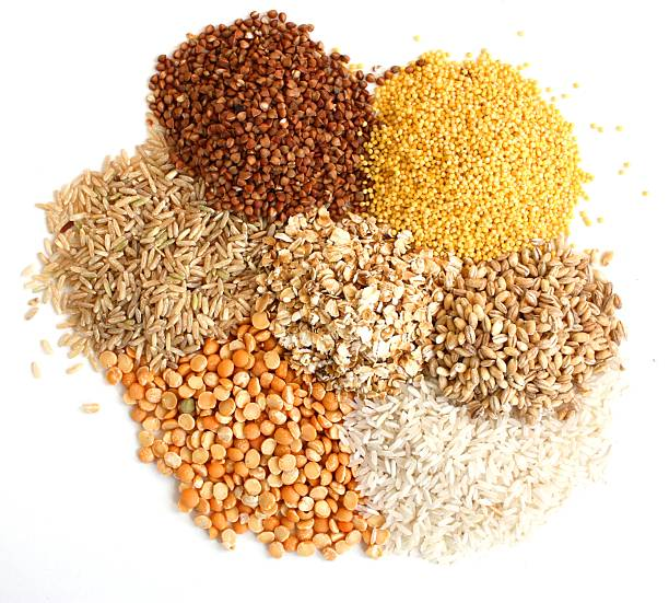 Piles of different types of grains stock photo