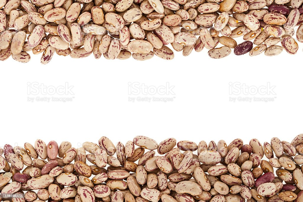Piles of dried pinto beans on a white background royalty-free stock photo