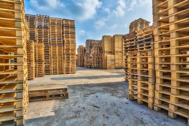 Piles of euro type cargo pallets stock photo