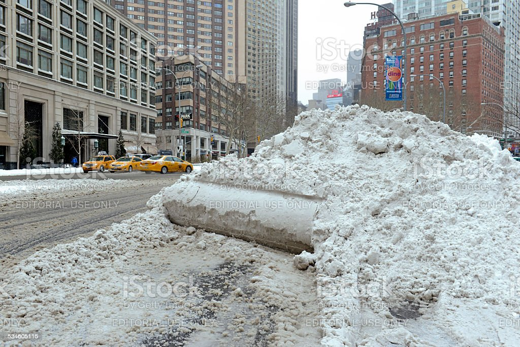 Piles of freshly plowed snow on streets, New York City stock photo