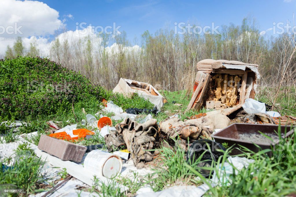 Piles Of Garbage And Old Furniture On An Illegal Dump Site