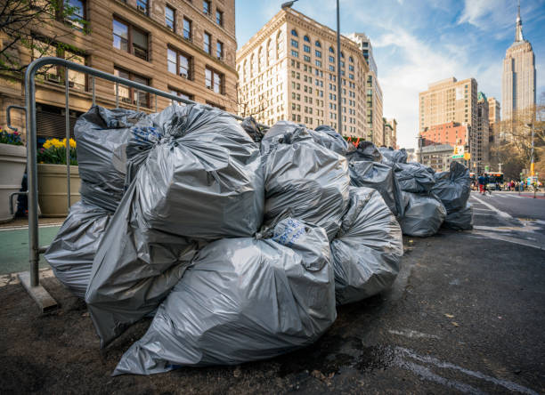 Piles of Garbage Bags on the street for collection in New York City stock photo