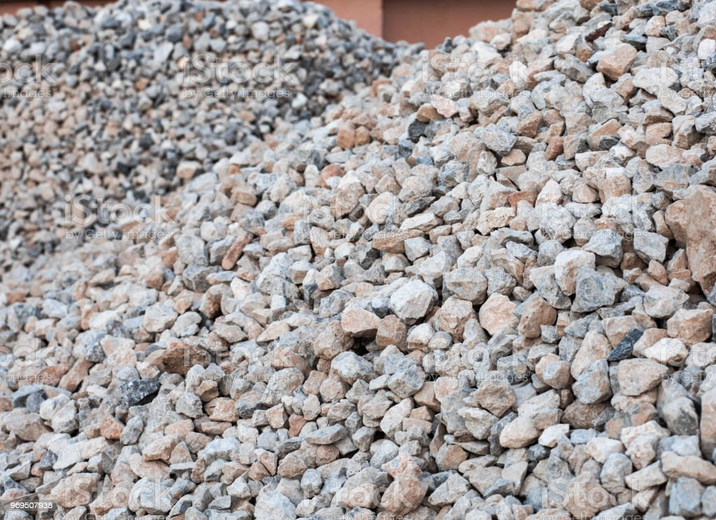 Piles of granite rocks at construction site, selective focus stock photo