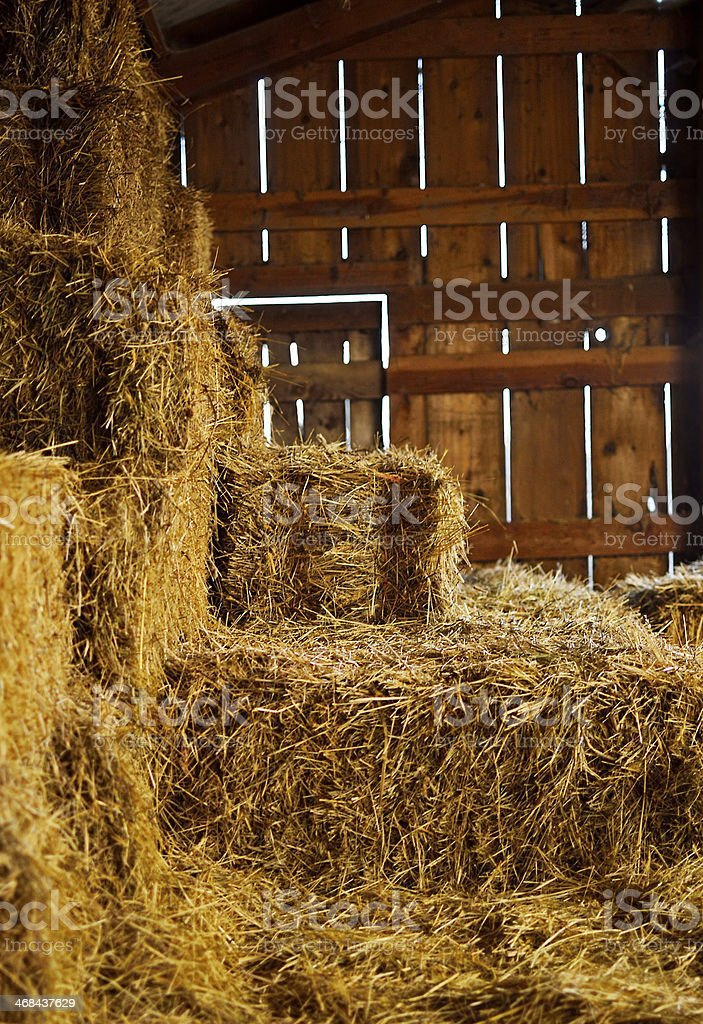 Piles of hay in a hayloft in a barn stock photo