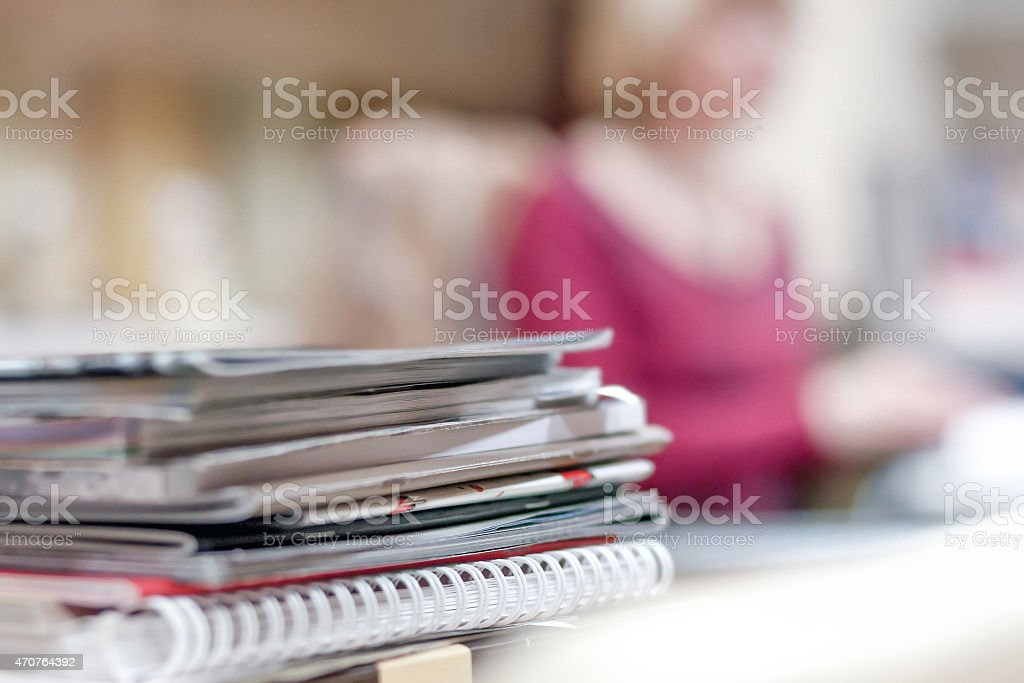 piles of magazines and brochures on the table stock photo