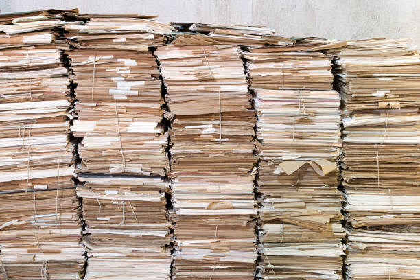 Piles of old papers Huges piles of old papers. Some of the papers are attached with string. bureaucracy stock pictures, royalty-free photos & images