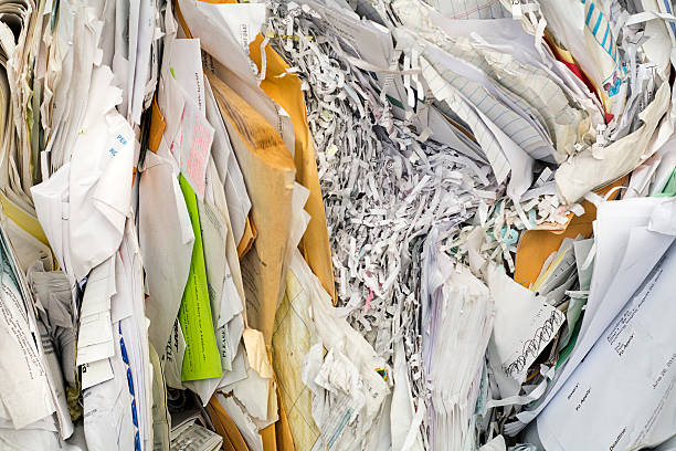 piles of paper shredded and ready to recycle stock photo
