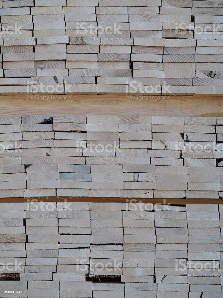 Piles of pine planks stacked for drying royalty-free stock photo