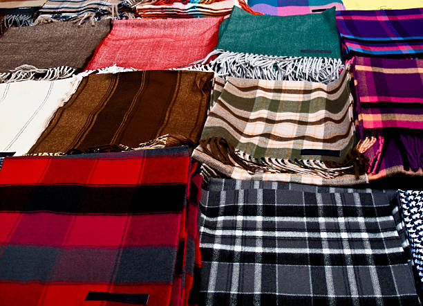 Piles of scarves on a table stok fotoğrafı