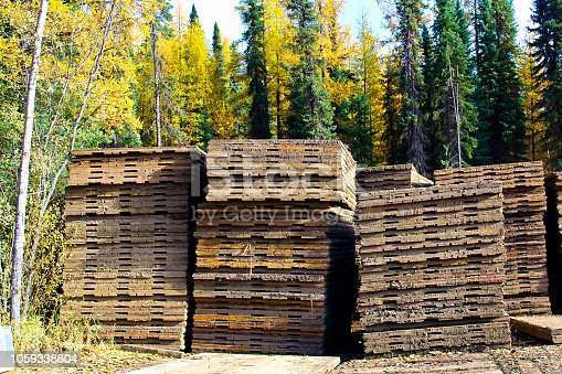 Piles of swamp mats used to build temporary roads.