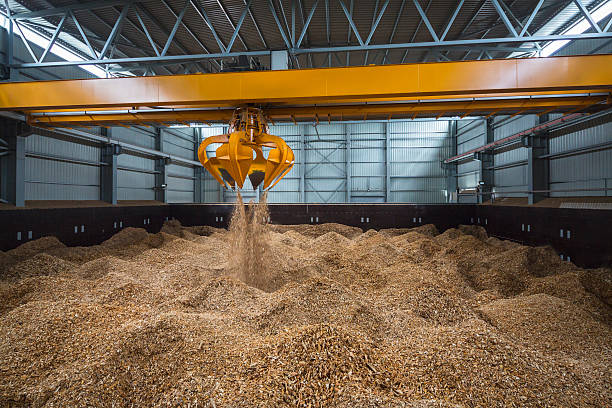 Piles of wood chips in storage stock photo