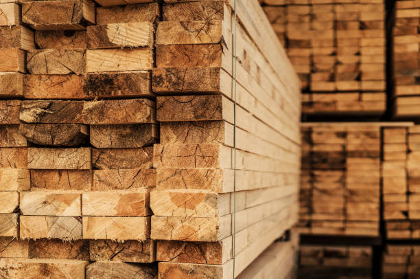 Piles of wood planks in timber yard stock photo