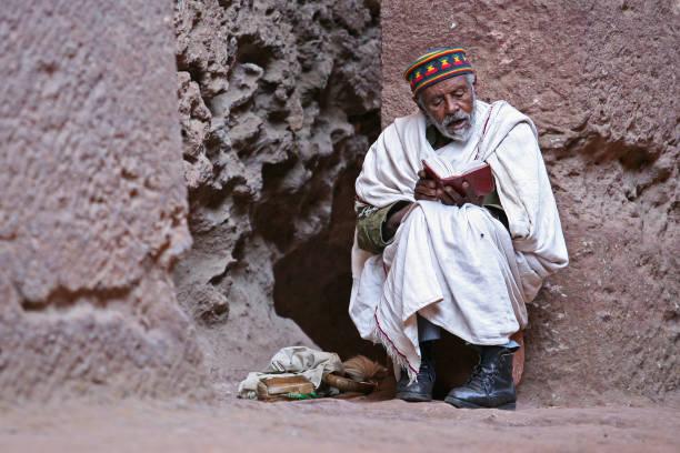 Pilgrim at the rock church of Lalibela - Ethiopia stock photo