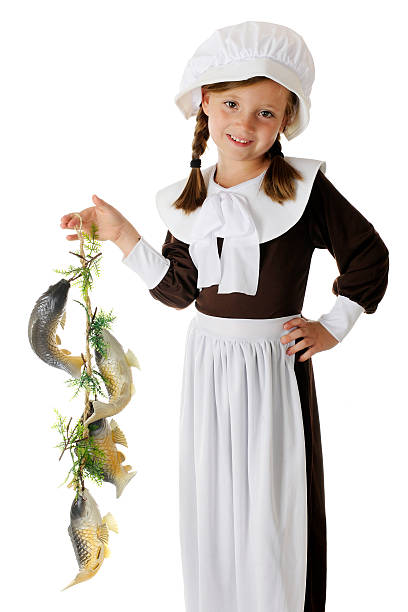 Pilgrim Catch A beautiful, elementary Pilgrim girl happily displaying the colony's catch of fish, a likely food for the first Thanksgiving feast.  On a white background. bonnet stock pictures, royalty-free photos & images