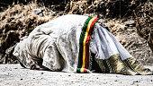 pilgrim man in traditional white clothes praying.