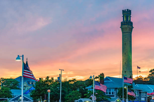 Pilgrim Monument and Provincetown during sunset Provincetown, MA Pilgrim Monument and Provincetown during sunset Provincetown, MA US provincetown stock pictures, royalty-free photos & images