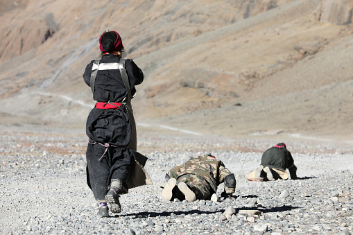 Pilgrim is on the way from their home town to the holy Mount Kailash, Tibet. There are thousands of pilgrims fulfill their faith by walking and kowtowing thousands of kilometer.