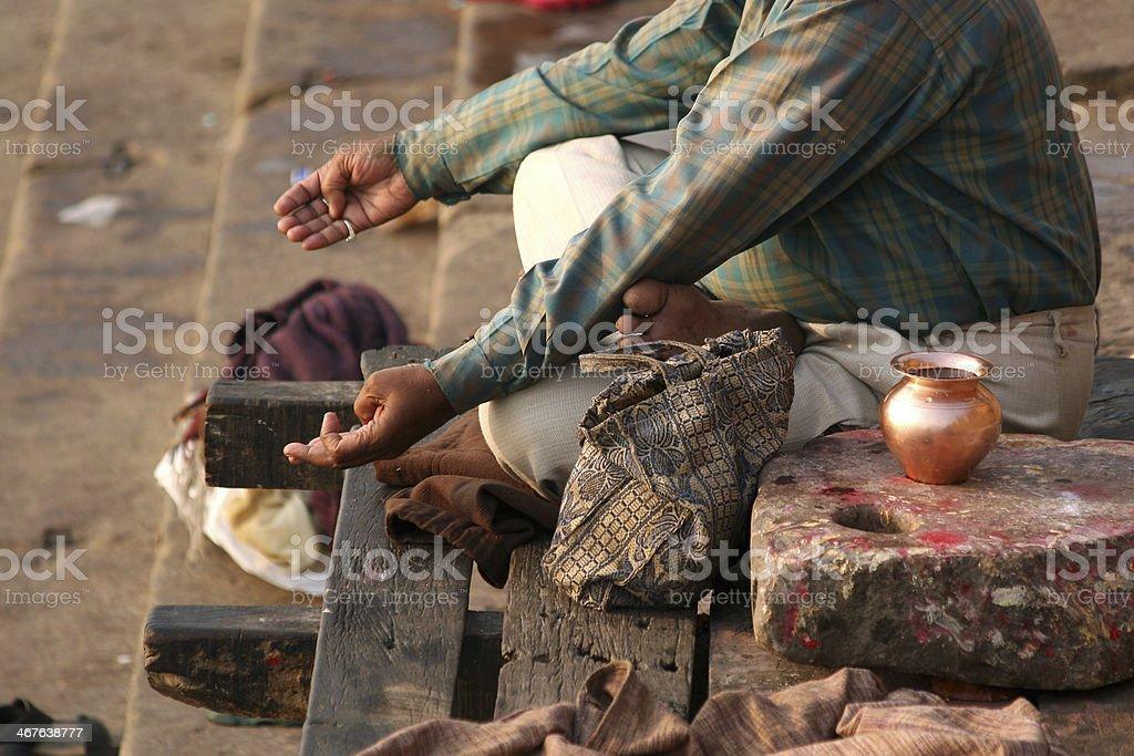 Pilgrim praying in front of river Ganges at Varanasi, India royalty-free stock photo