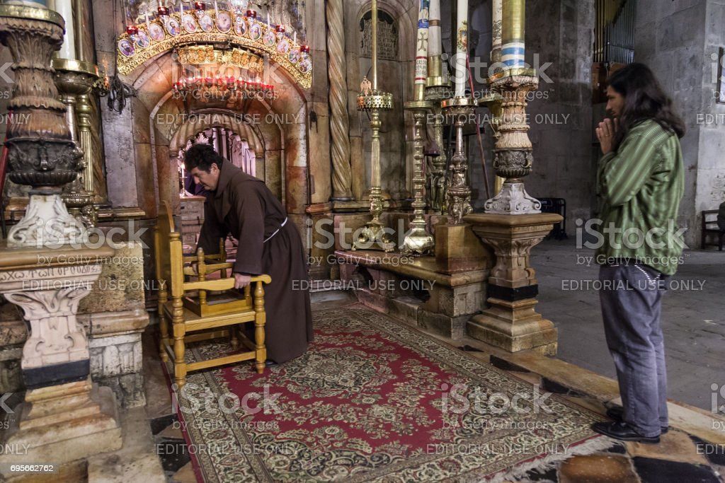 Pilgrim prays in the Church of the Holy Sepulchre stock photo