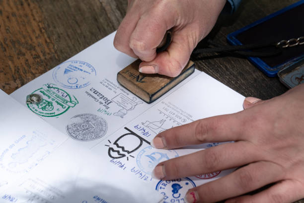 Pilgrim stamping a identification named The Compostela stock photo
