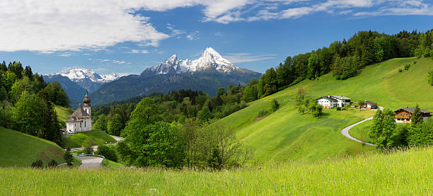 Pilgrimage Church Maria Gern with Watzmann in background Maria Gern Church in Bavarian Alps on Mountain Panorama view bavarian alps stock pictures, royalty-free photos & images