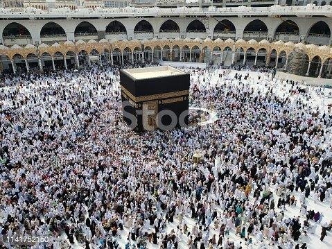 Pious Muslim flocking to the kaba during the hajj pilgrimage