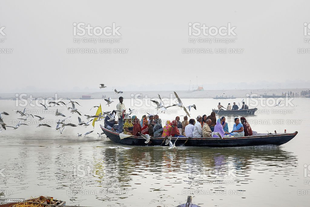 Pilgrims and tourists in boat on River Ganges at dawn royalty-free stock photo