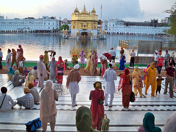 Pilgrims at the Golden Temple stock photo