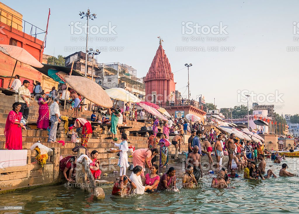 Pilgrims bathing in Dasaswamedh Ghat Varanasi stock photo