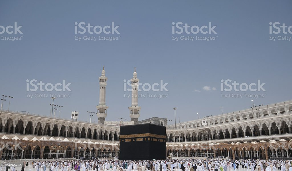 Pilgrims circumambulate the Kaaba at Masjidil Haram stock photo
