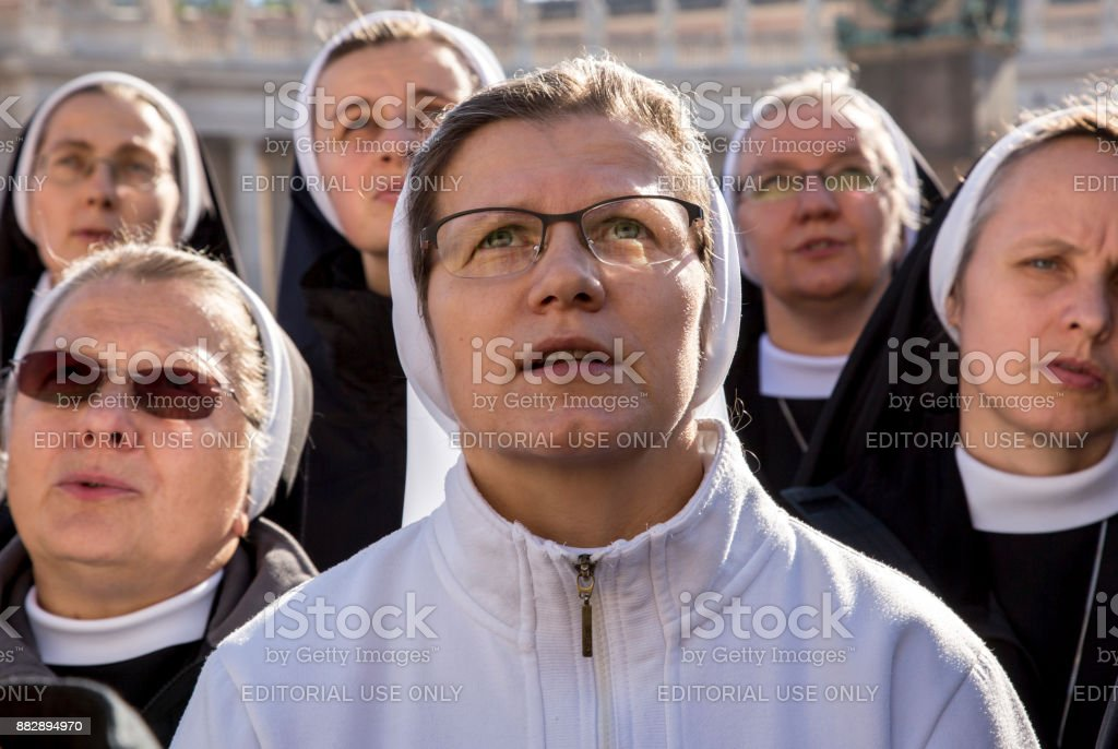 Pilgrims during Urbis et Orbis prayer stock photo