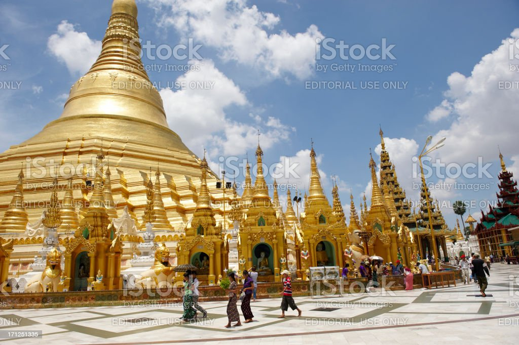 Pilgrims in Shwedagon Pagoda complex royalty-free stock photo