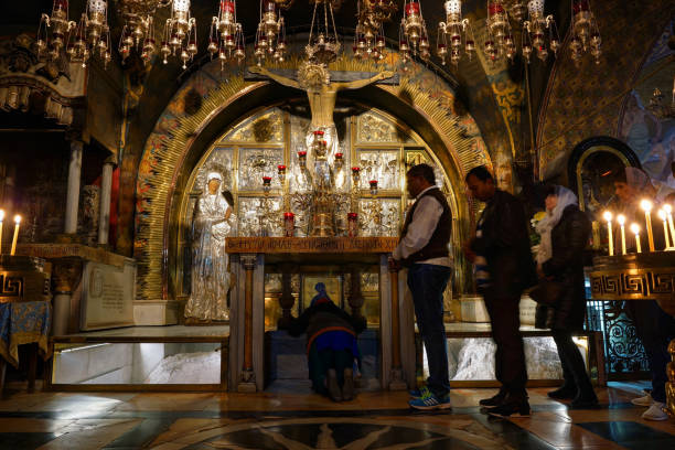 Pilgrims in the Calvary Chapel in the Church of the Holy Sepulchre stock photo