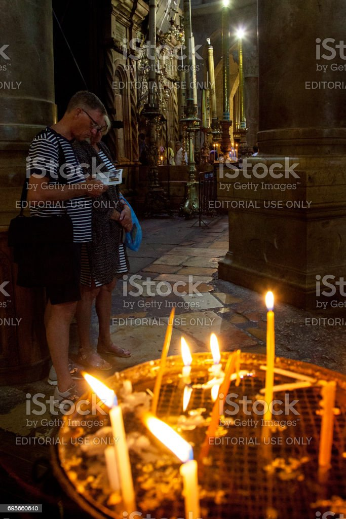 Pilgrims in the Church of the Holy Sepulchre in Jerusalem stock photo