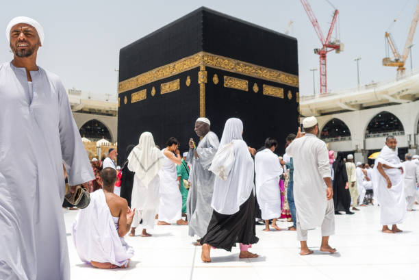 Pilgrims making Tawaf around Holy Kaaba in Mecca Tawaf is a ritual during Umra or Hajj when pilgrims making seven circles around The Holy Kaaba in Masjid Al Haram umrah stock pictures, royalty-free photos & images