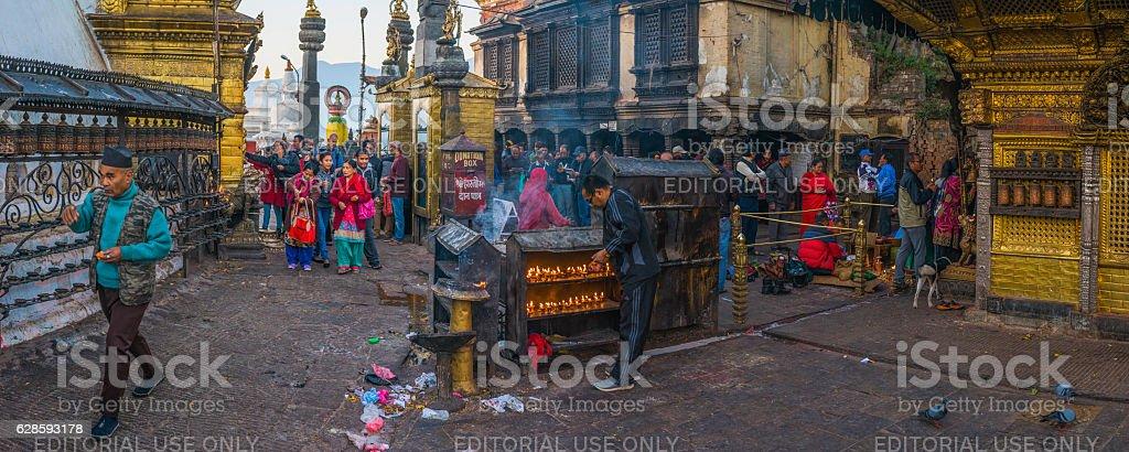 Pilgrims morning prayers at Swayambhunath monkey temple panorama Kathmandu Nepal stock photo