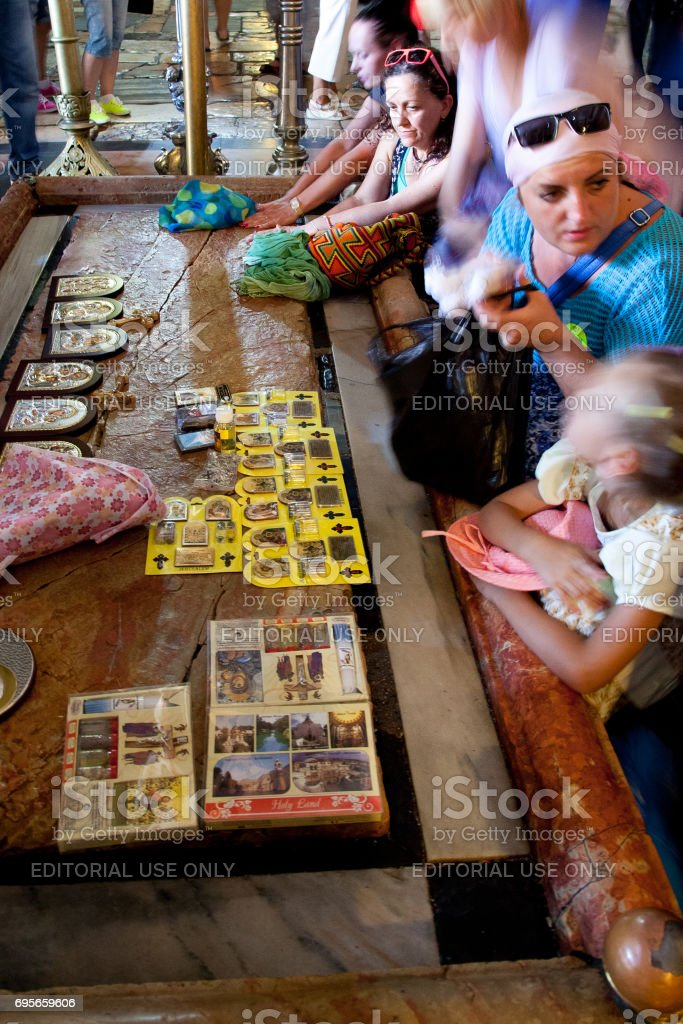 Pilgrims pray in the Church of the Holy Sepulchre in Jerusalem stock photo