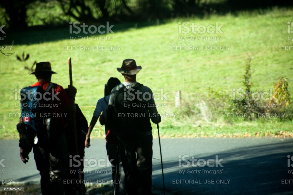 Pilgrims silhouetted, walking in the 'camino de Santiago'. stock photo