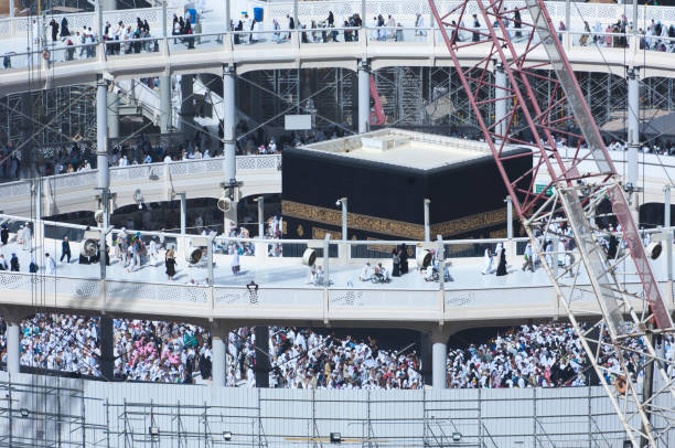 Pilgrims Tawaf Around Al-Kaaba While Construction Works Are Going on at Al Haram in Mecca Pilgrims Tawaf Around Al-Kaaba While Construction Works Are Going on at Al Haram in Mecca, Saudi Arabia circumambulation stock pictures, royalty-free photos & images