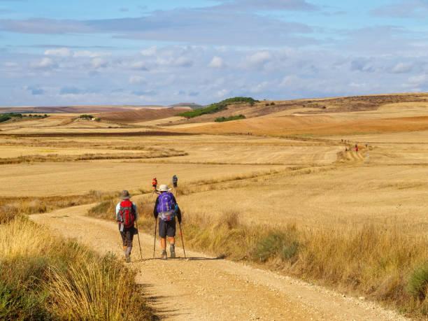 Pilgrims through the Meseta - Castrojeriz stock photo