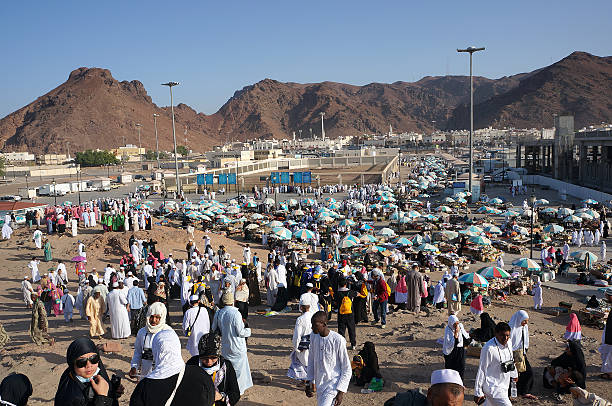 Pilgrims visit Jabal Uhud Medina, Saudi Arabia - September 21, 2013: View from top of the Jabal Uhud in September 21, 2013 in Medina, Saudi Arabia. Jabal Uhud is one of historical place in Islamic history. circumambulation stock pictures, royalty-free photos & images