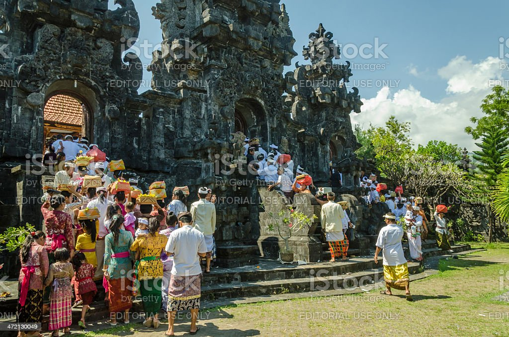 Pilgrims walking to a temple ceremony in Bali - Indonesia royalty-free stock photo