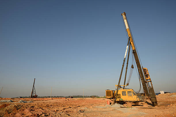 piling works vehicle on an empty land - pillar drill stock photos and pictures