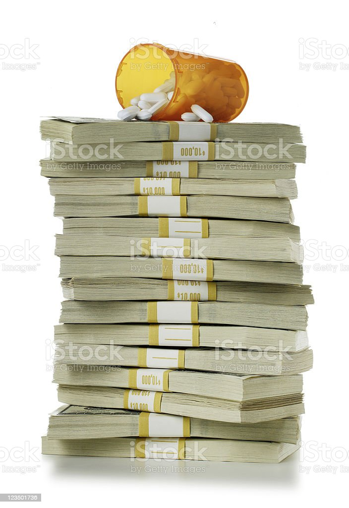 Pill Bottle and a Pile of Money Isolated on White stock photo