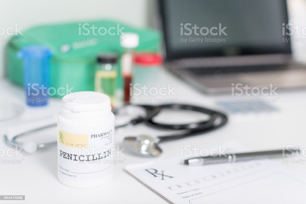 Pill bottle on a doctor's desk with penicillin stock photo