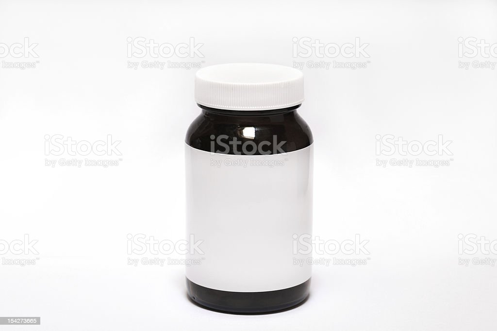 Pill bottle on white background royalty-free stock photo