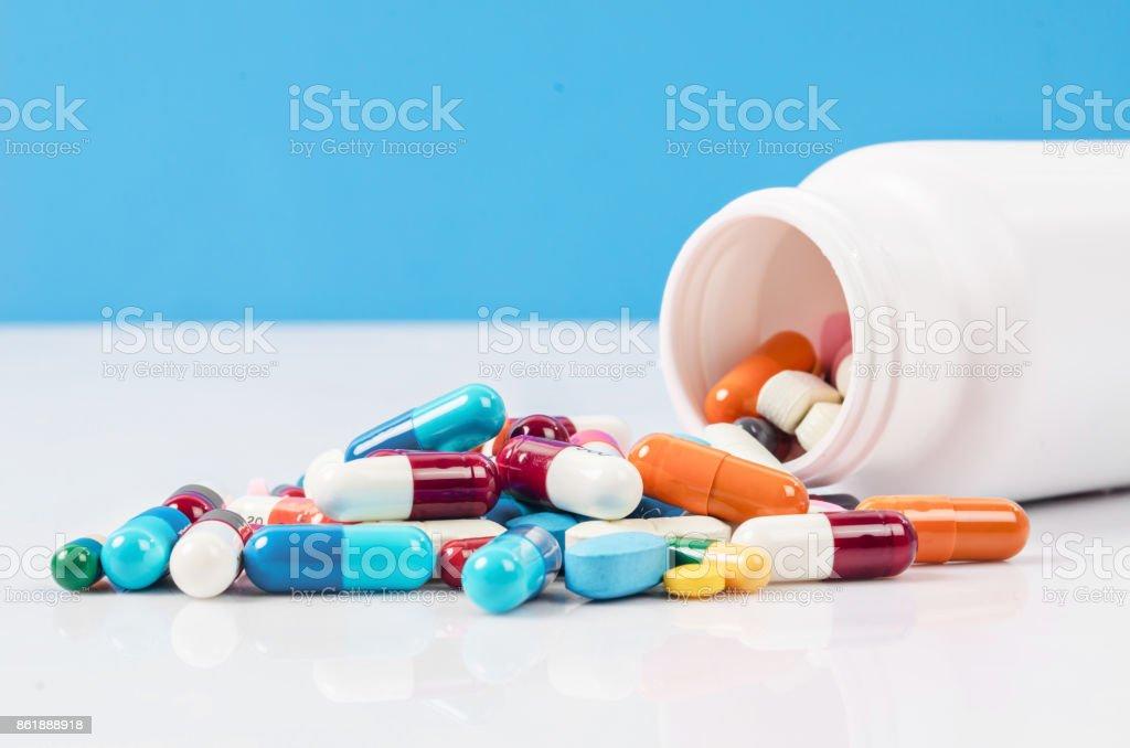 Pill bottle with pill spill stock photo
